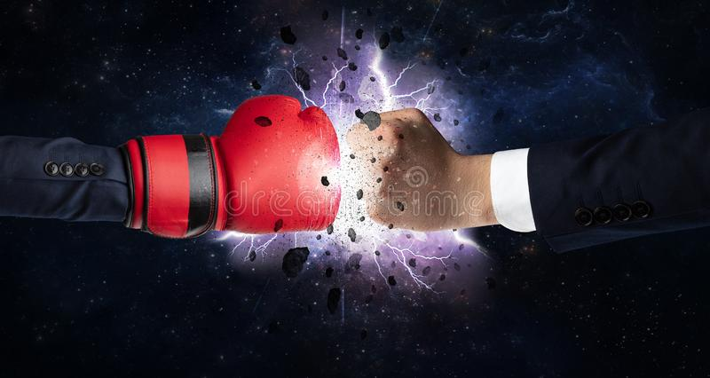 Fighting hands with storm explosion. Two hands fighting with storm explosion concept royalty free stock image