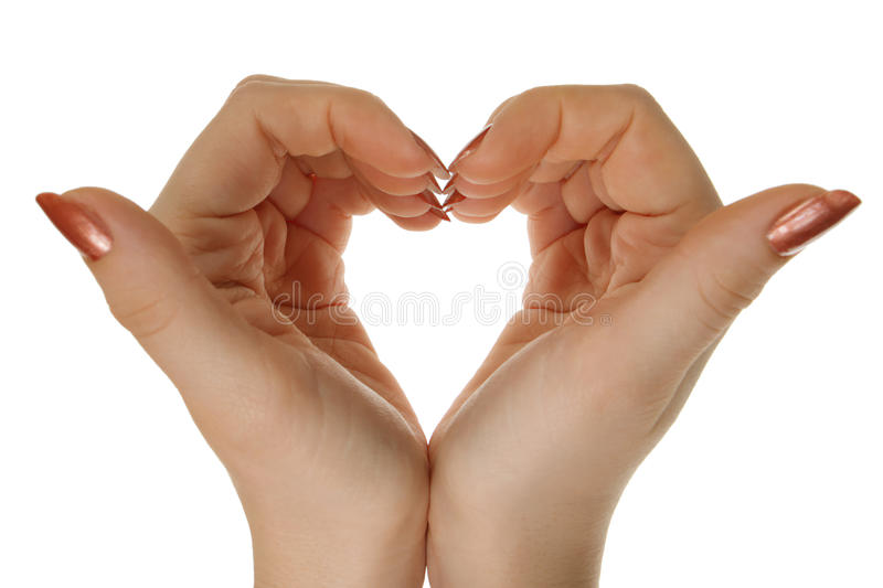 Two hands form a heart shape. Isolated stock photos