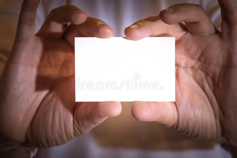 Two hands holding a blank business card royalty free stock images