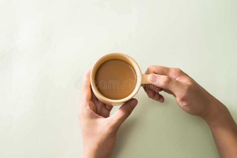 Breakfast concept with coffee or tea. Good morning. Two hands holding a cup with hot coffee on white  background. Breakfast concept with coffee or tea. Good stock image