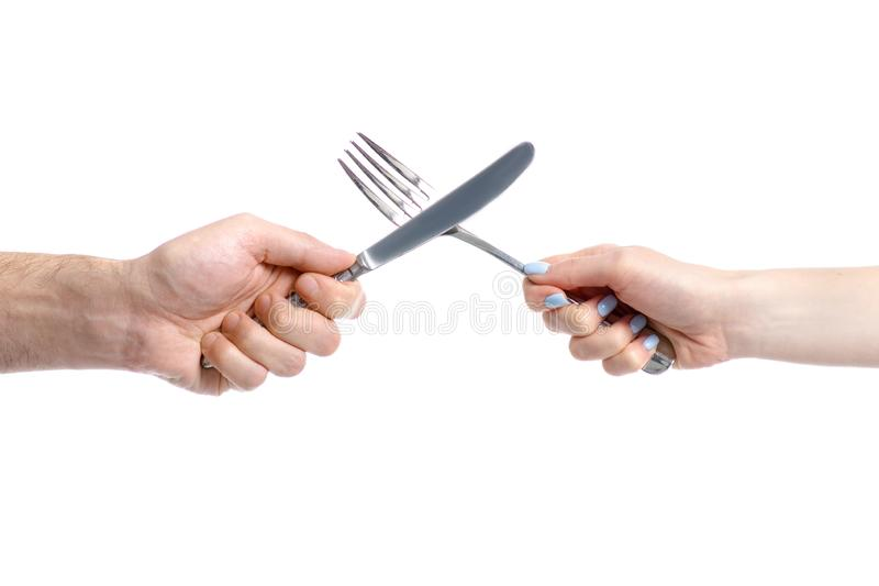 Two hands holding fork and knife stock image