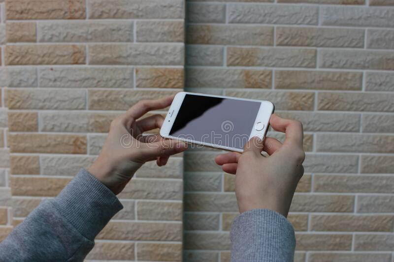Two hands holding smart phone stock photo