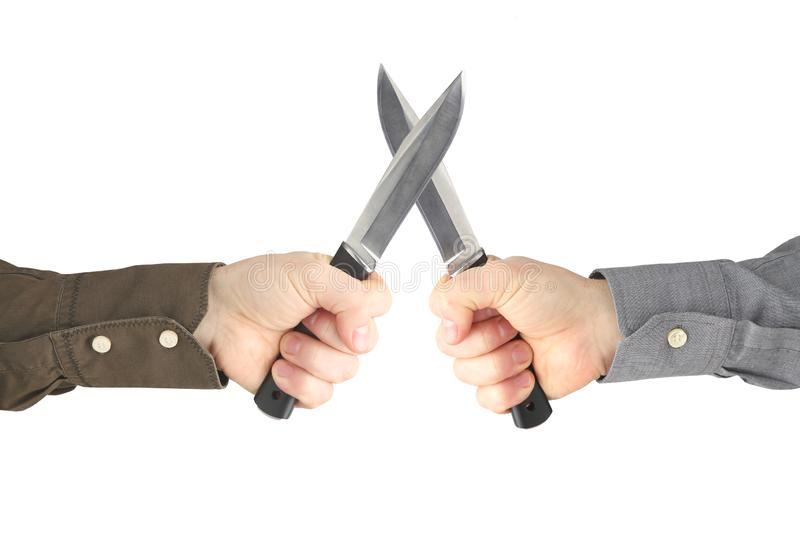 Two hands with knives facing each other. Confrontation and war stock images