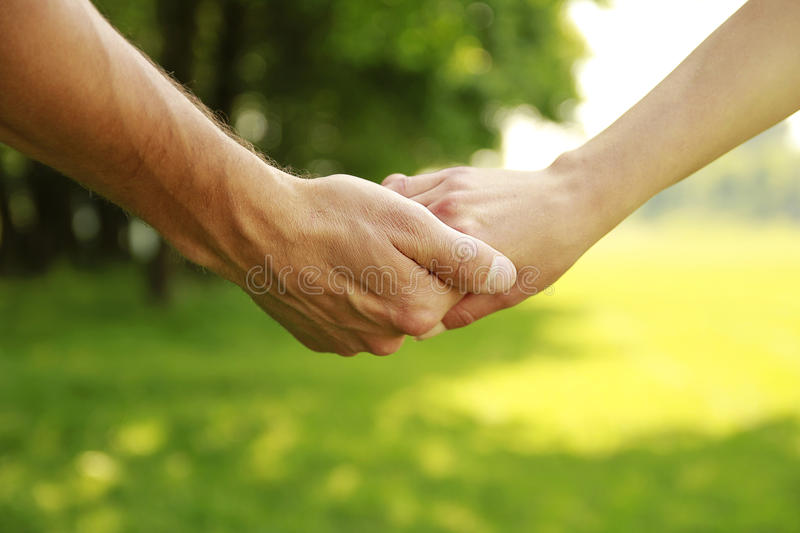 Two hands in love couple on nature royalty free stock photo