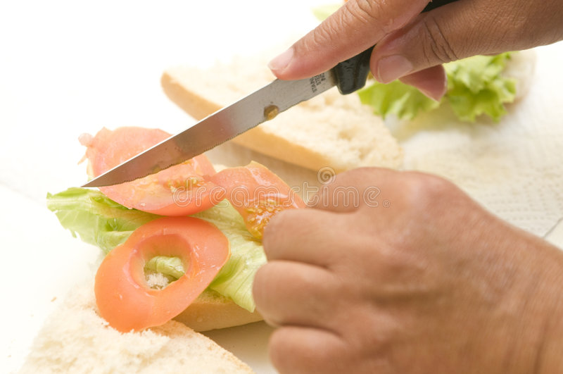 Two Hands Making A Vegetal Sandwich Royalty Free Stock Photo