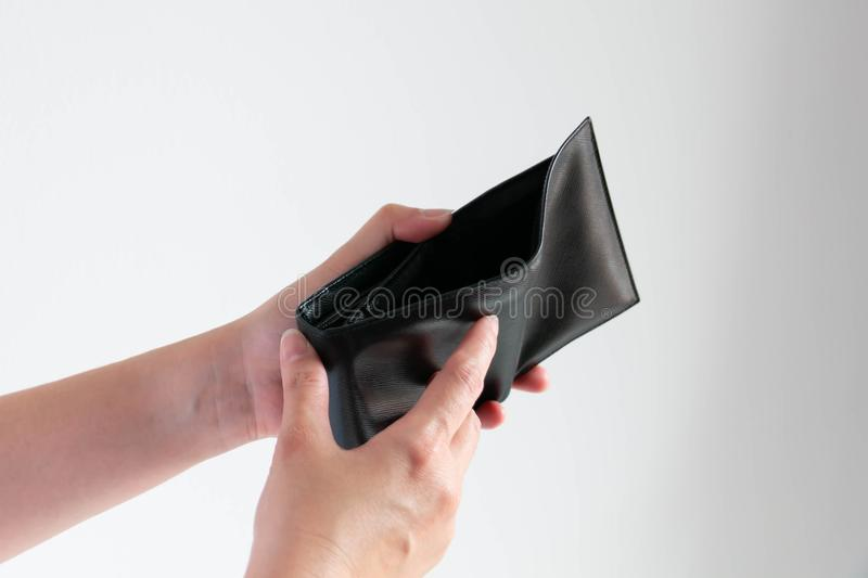 Empty wallet in hands on white background. Two hands open empty wallet on white background; the wallet that no money; concept of financial crises royalty free stock image