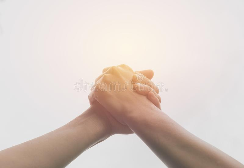 Two hands reaching toward each other. Teamwork and helping stock photos