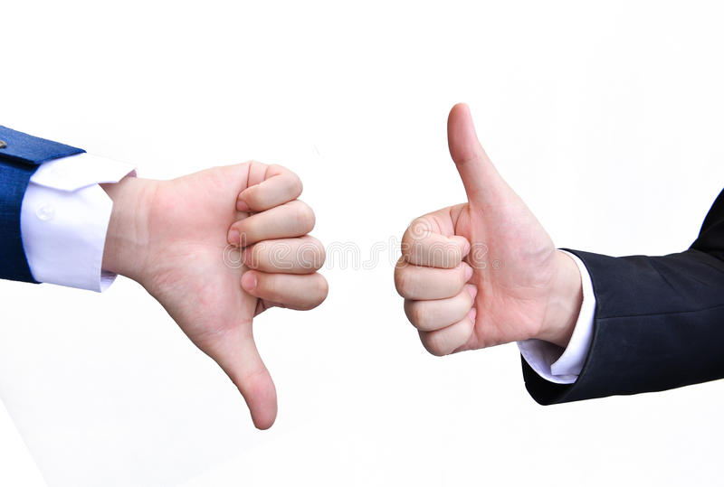 Two hands signalling thumbs up and thumbs down. On white background royalty free stock image
