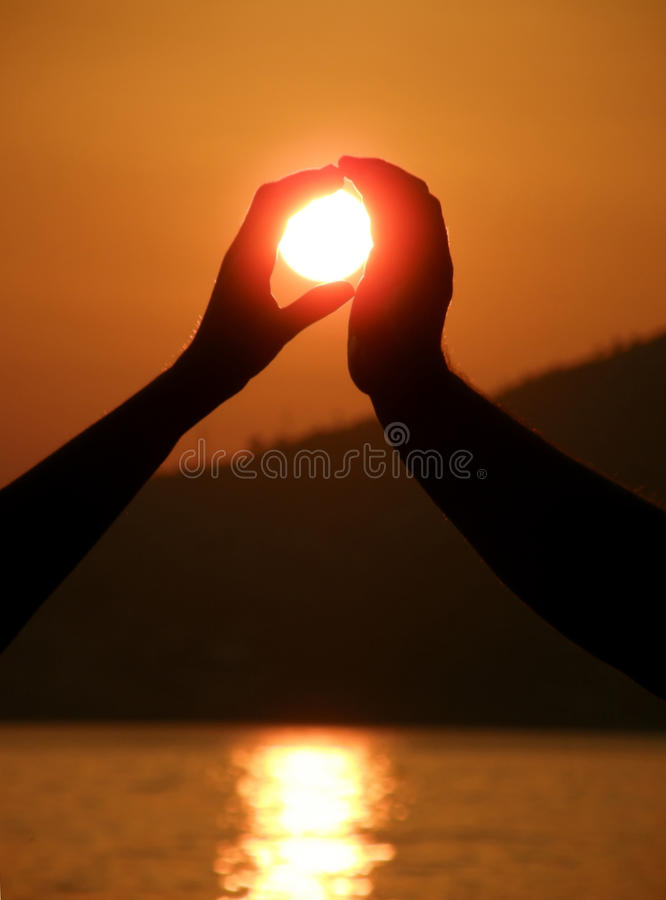 Two hands take a sun royalty free stock image