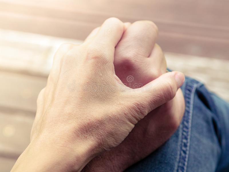 Two hands together, a man and a woman holding hands. Husband and. Wife together. Support and understanding royalty free stock photo