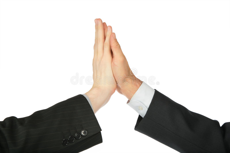 Two hands, which are touched by palms. On white background royalty free stock photo