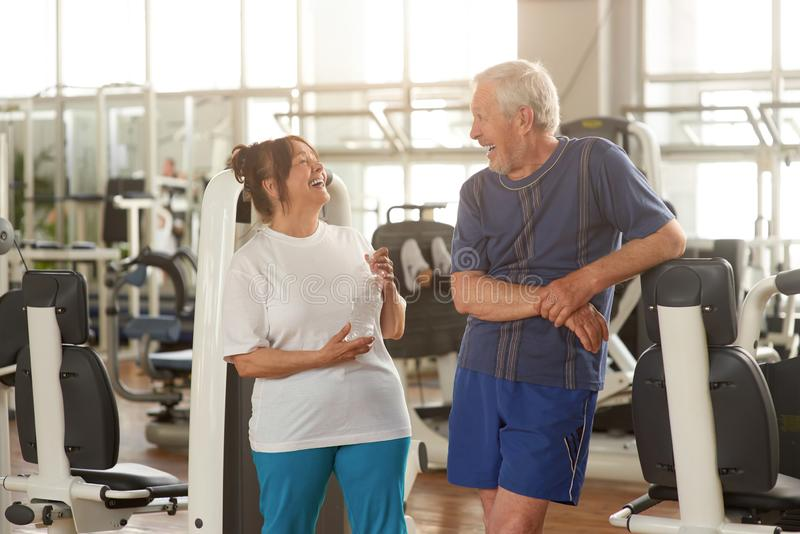 Two happpy senior people at gym. stock images