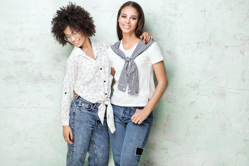 Two happy african american girls posing. royalty free stock photography