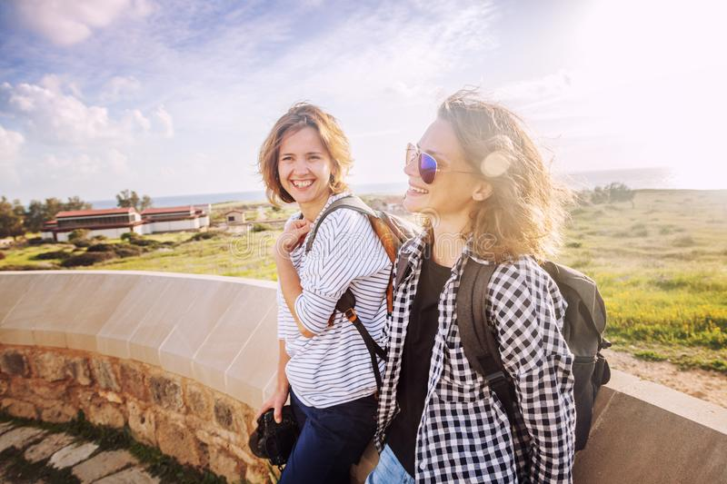 two happy attractive young girls traveling together, summer holiday and vacation, joy and communication, Friendship Day stock photography