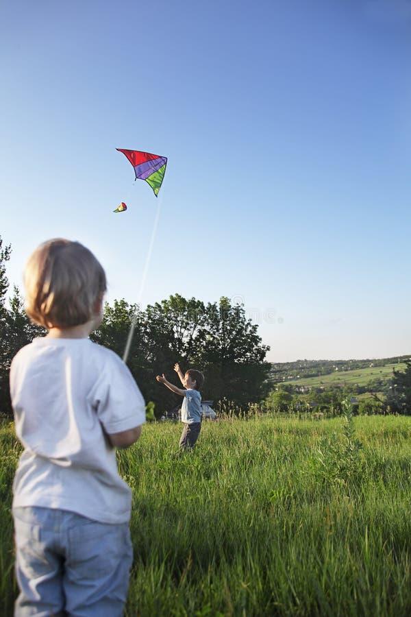 Free Two Happy Boy With Kite Stock Photo - 37961390
