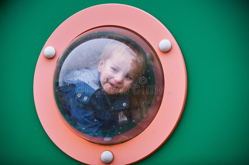 Two Happy boys playing at the playground stock images
