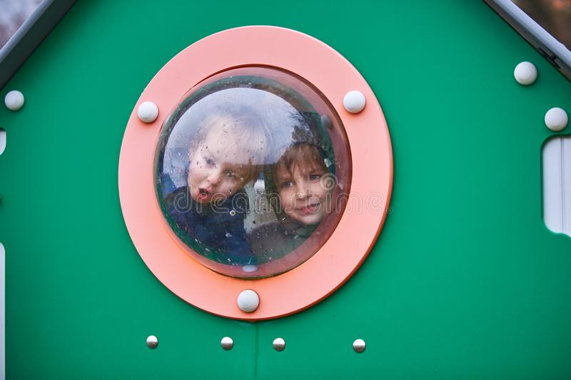 Two Happy boys playing at the playground royalty free stock images