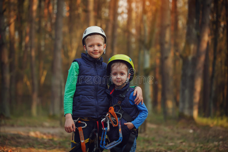Two happy brave adorable brothers, double portrait, looking at. The camera at adventure park stock photography