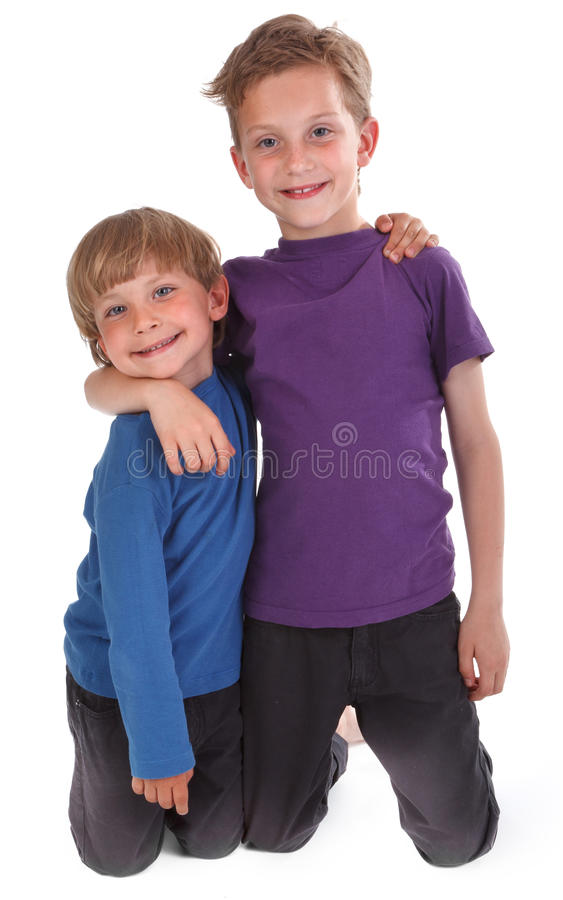 Two happy brothers against white royalty free stock photos