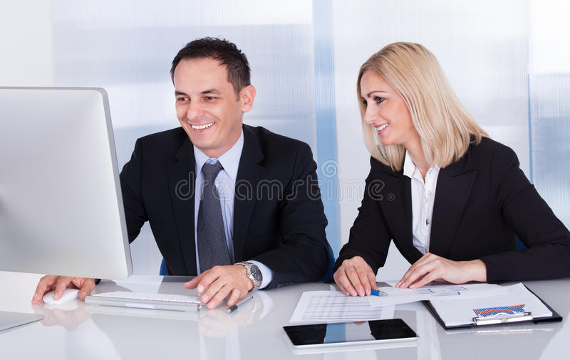 Two Happy Business Colleagues At Office stock photos