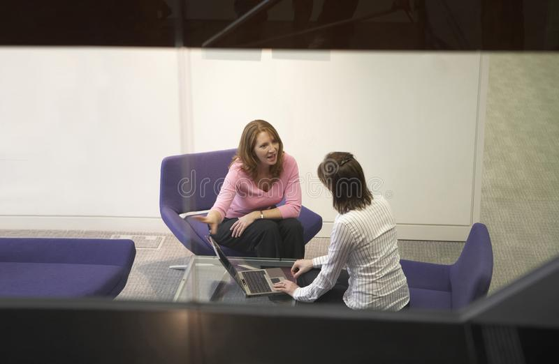 Two happy business woman in a business meeting royalty free stock photography