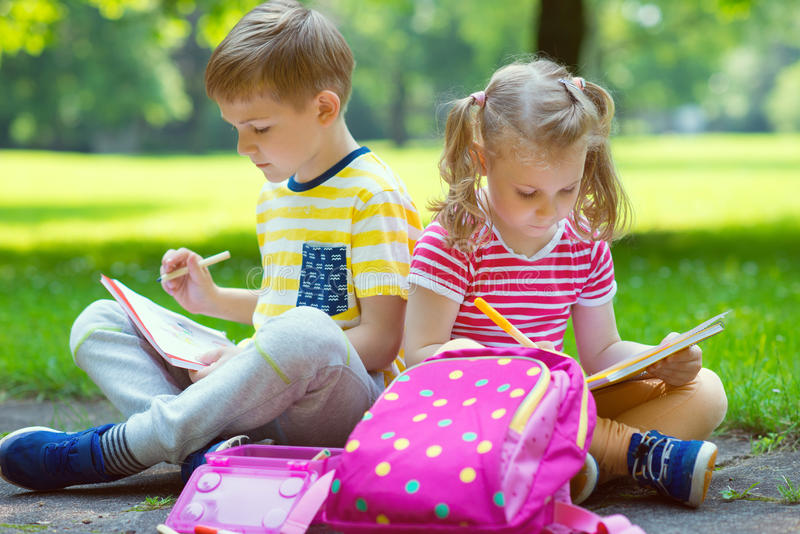 Two happy children in park stock photography