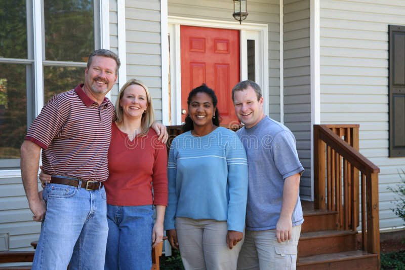 Two Happy Couples. Standing outside a new home royalty free stock image