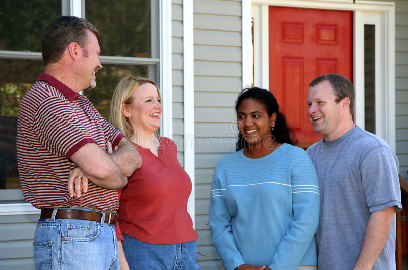 Two Happy Couples. Standing outside a new home stock photos