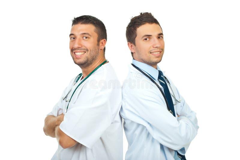 Two happy doctors men stock images