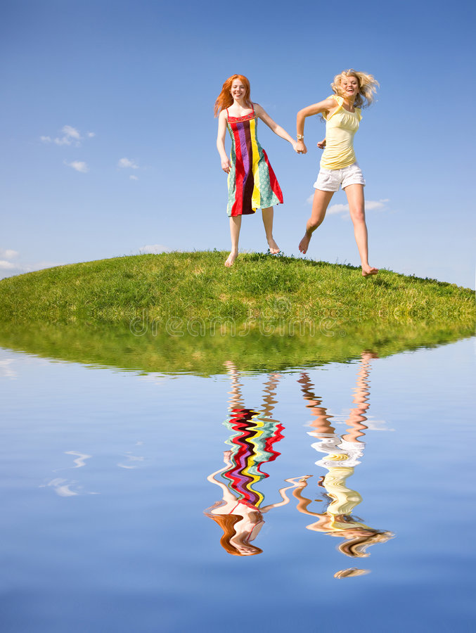 Download Two Happy Girls Fleeing On A Meadow Stock Photo - Image: 5567020