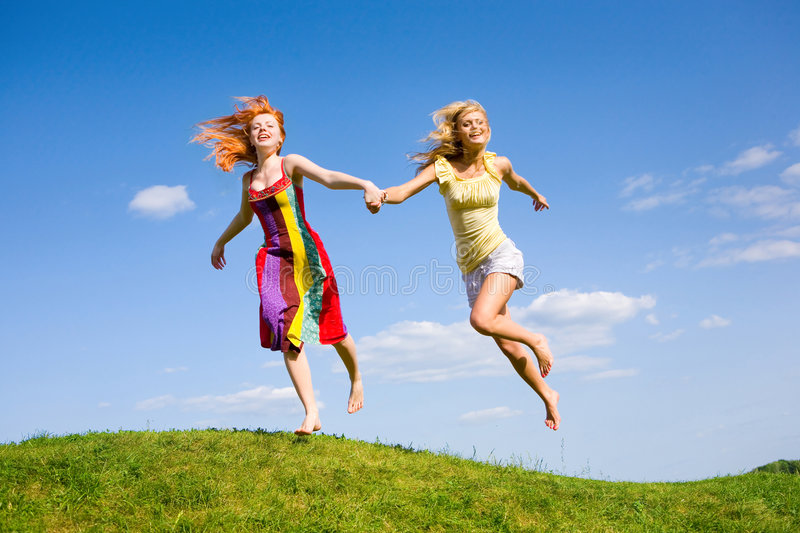Download Two Happy Girls Fleeing On A Meadow. Stock Photo - Image of adult, hair: 6415638