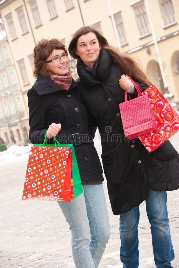 Download Two Happy Girls Fter Shopping Stock Photo - Image of clothing, gift: 13261880