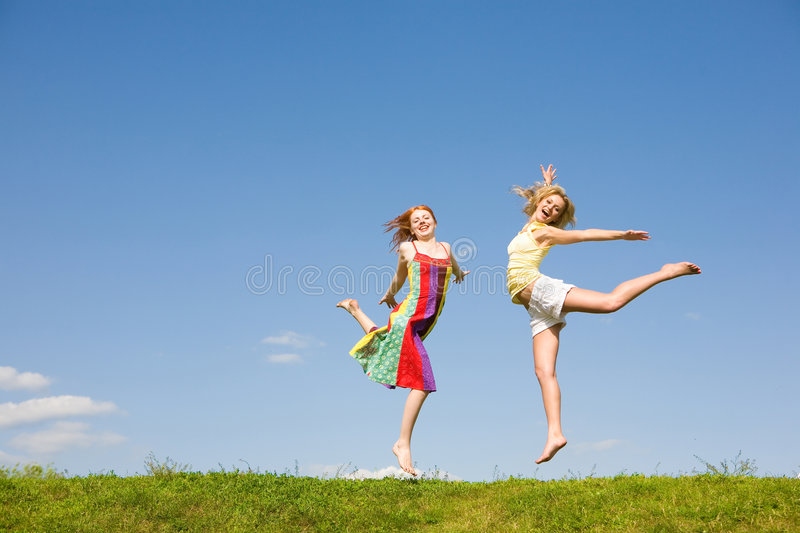 Download Two happy girls jumping stock image. Image of green, girls - 8106165