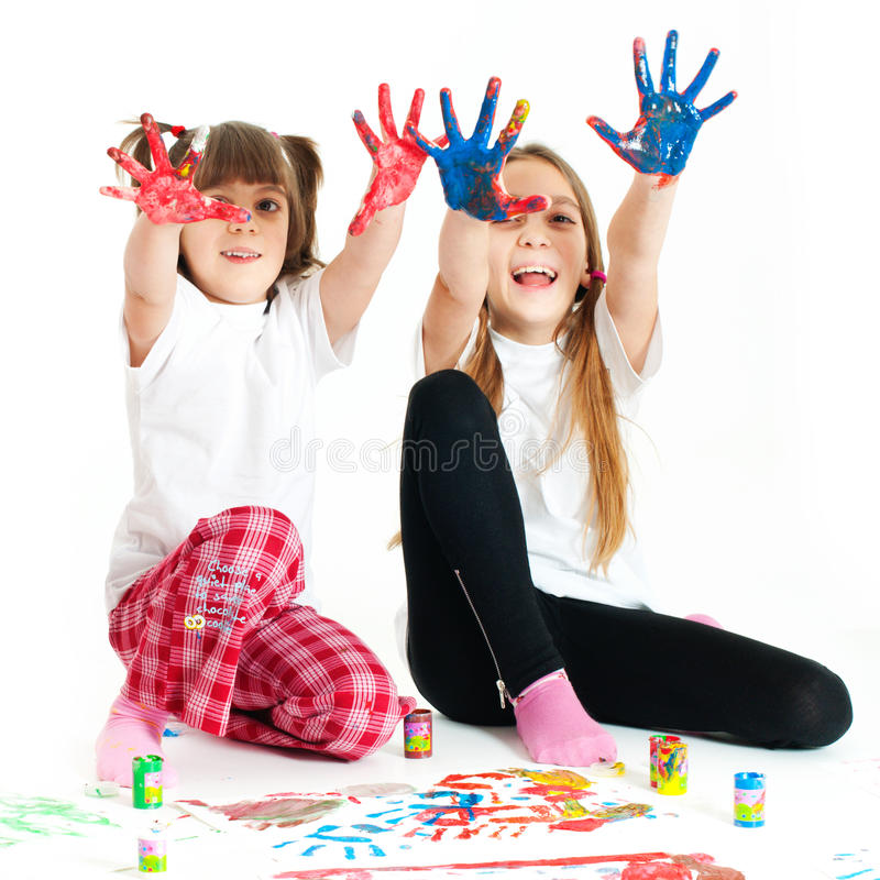 Download Two Happy Girls Playing With Finger Colours Stock Photo - Image: 24873030