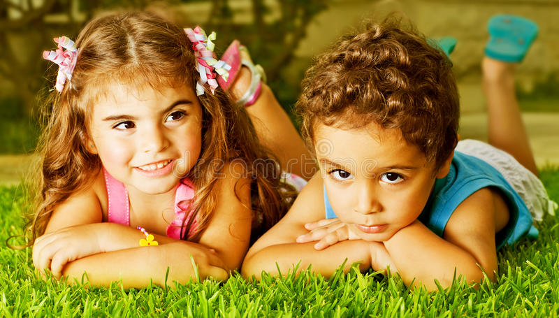 Download Two happy kids stock image. Image of care, children, grass - 26964623