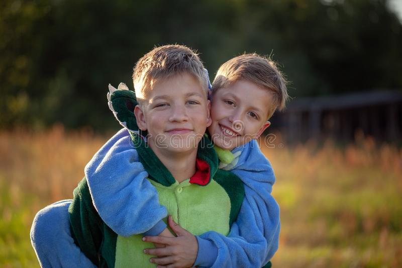 Two happy kids boys, funny siblings fun together. Brothers playing outdoors in summer day, best friends concept. Close up portrait two happy kids boys, funny royalty free stock photos