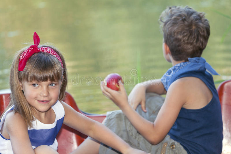 Two happy kids playing on the boat at summer day royalty free stock image