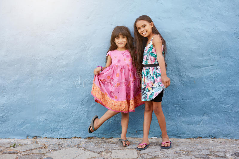 Two happy little girls posing together stock photo