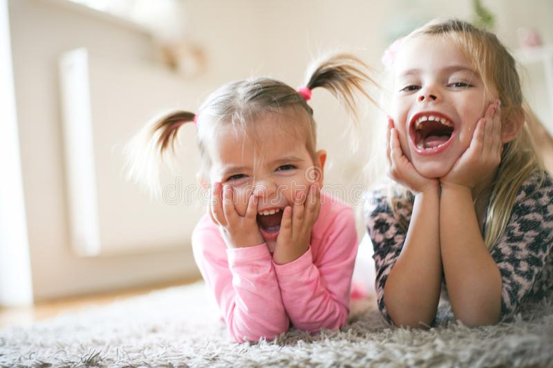 Two happy little girls. stock image