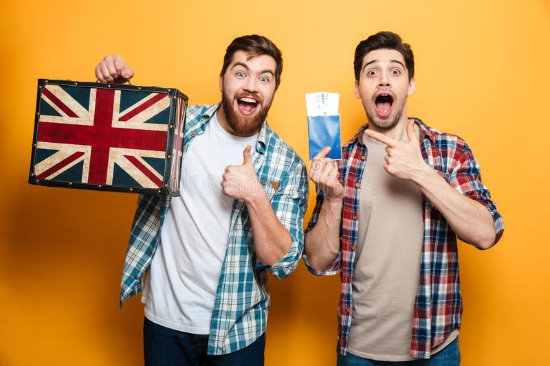 Two happy men in shirts preparing to trip while rejoices royalty free stock images