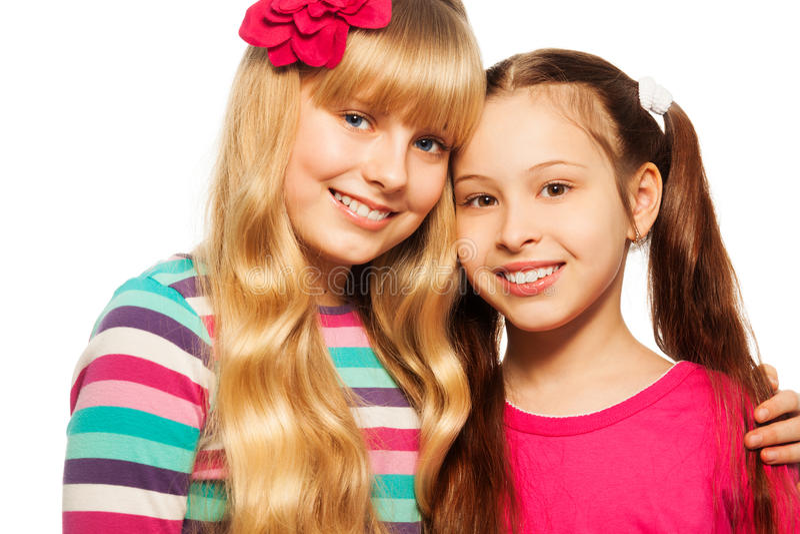 Two happy school girls stock images