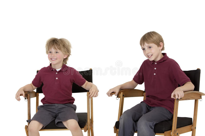 Download Two Happy School Kids Sitting On Directoru0027s Chair Over White  Background Stock Image   Image