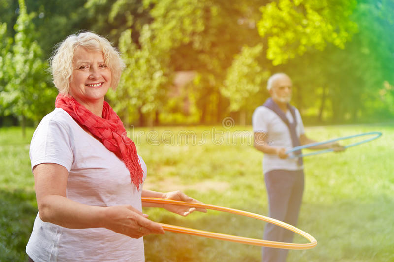 Two happy seniors playing with hoops stock photo