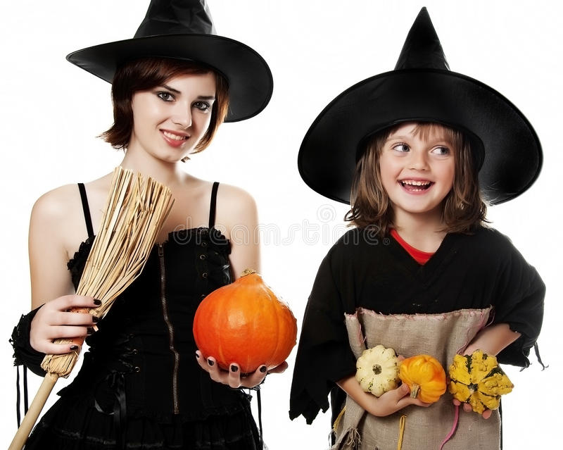 Two happy sisters with hallowen witch masks. White background royalty free stock images
