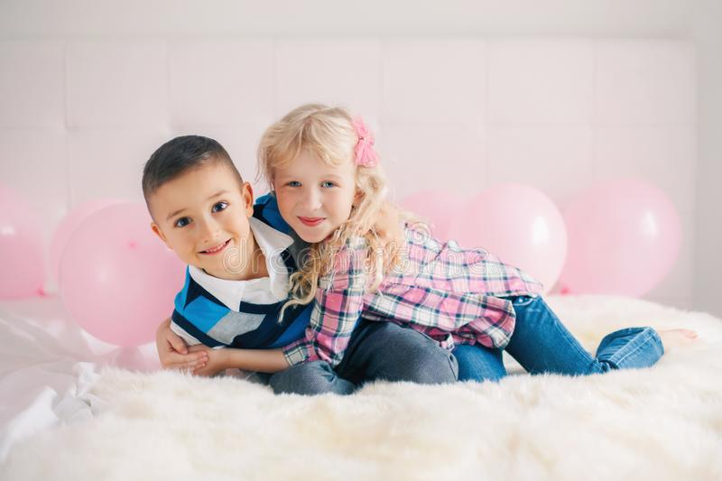 Two happy smiling white Caucasian cute adorable funny children. Boy and girl. Portrait of two happy smiling white Caucasian cute adorable funny children. Boy and stock images