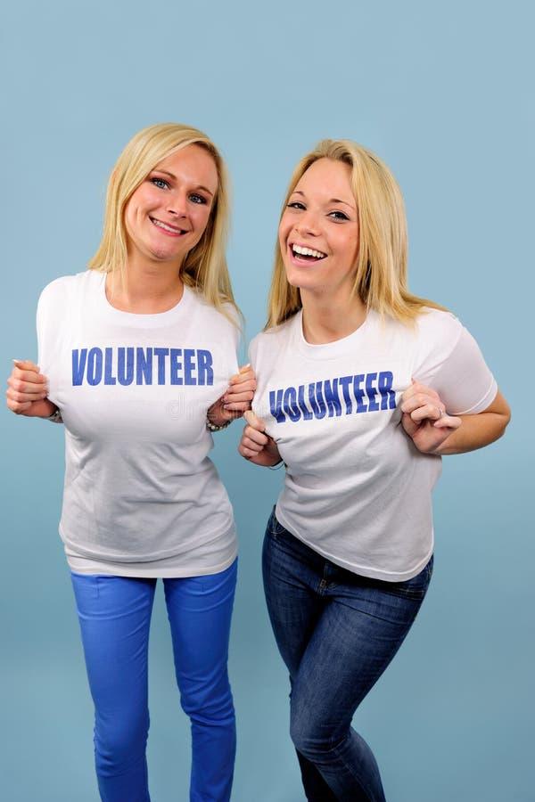 Download Two happy volunteer girls stock image. Image of posing - 23733861
