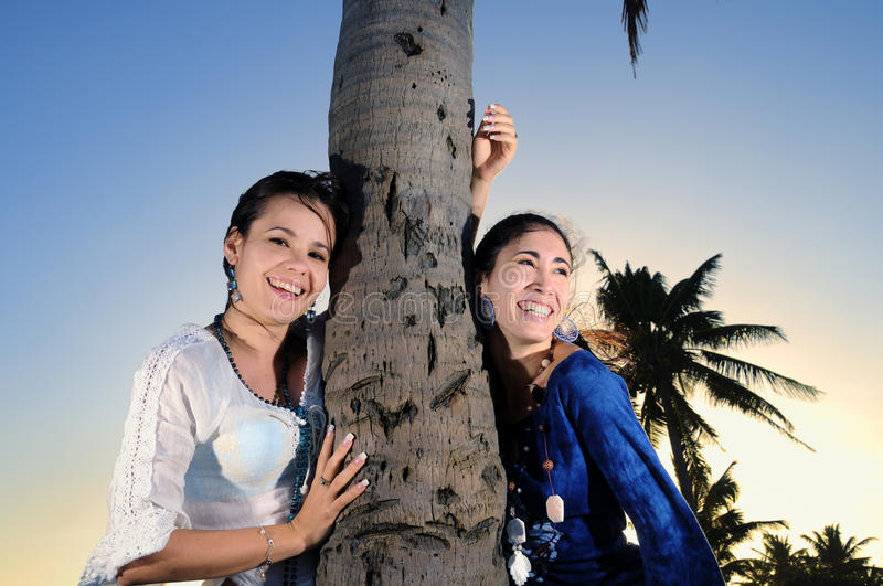 Two happy women on the beach stock images