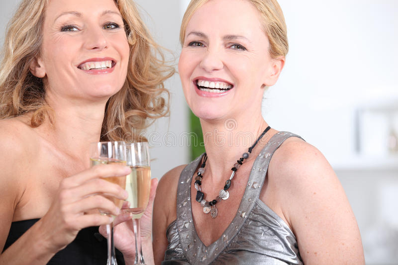 Women drinking champagne stock images