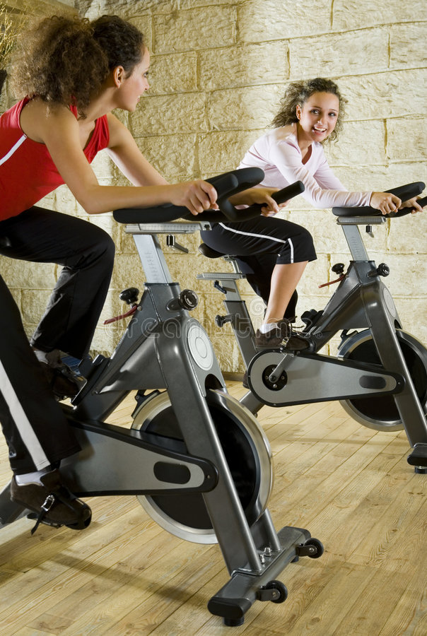 Download Two Happy Women Working Out On Exercise Bikes Stock Photos - Image: 4240823