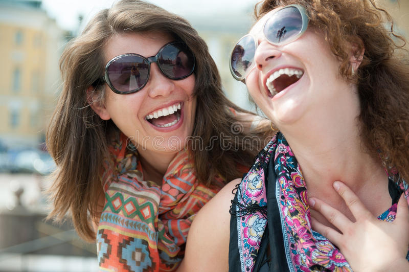 Two happy young beautiful women royalty free stock images